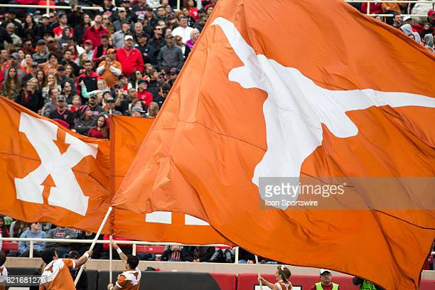 Texas cheerleader wavies the fag after a touchdown during the game between Texas Longhorns and Texas Tech Red Raiders on November 5 at Jones ATT...