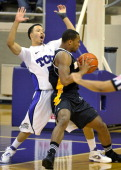 Texas Christian Horned Frogs guard Kyan Anderson is fouled by Milwaukee Panthers guard Ryan Allen in the first half of the College Basketball...
