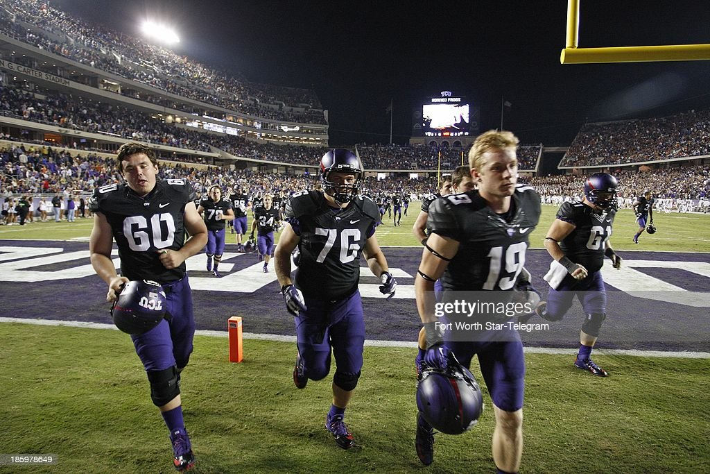 Texas Christian players leave the field just before halftime after officials stopped play against Texas due to lightning in the area at Amon Carter Stadium in Fort Worth, Texas, on Saturday, October 26, 2013.