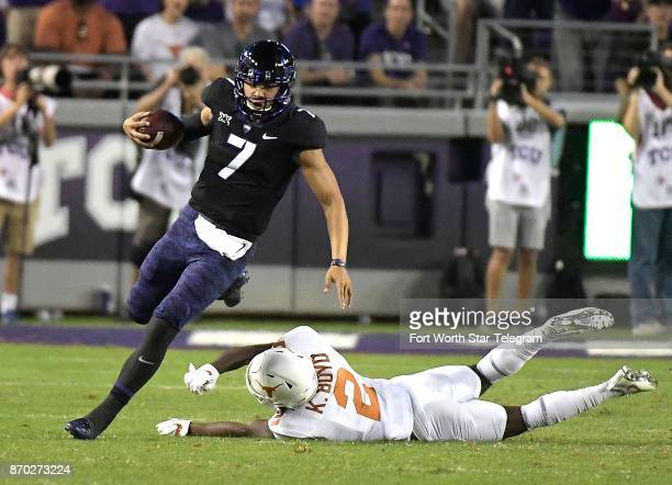 Texas Christian quarterback Kenny Hill scrambles for a first down during the first quarter as Texas defensive back Kris Boyd can't bring him down at...