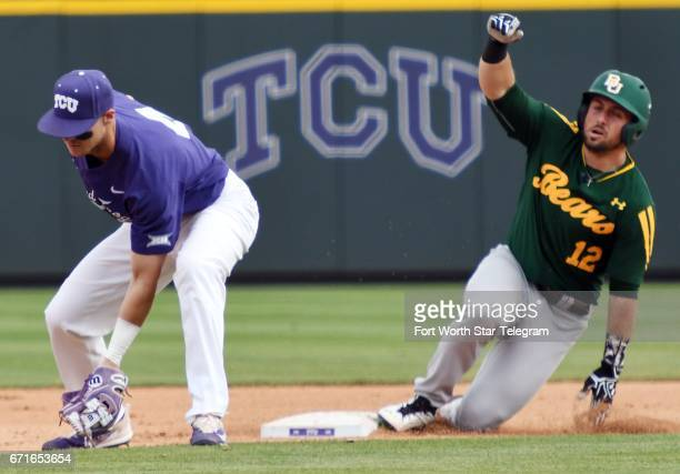 Texas Christian second baseman Cam Warner takes the throw from the outfield as Baylor's Matt Menard slides into second base with an RBI double in the...