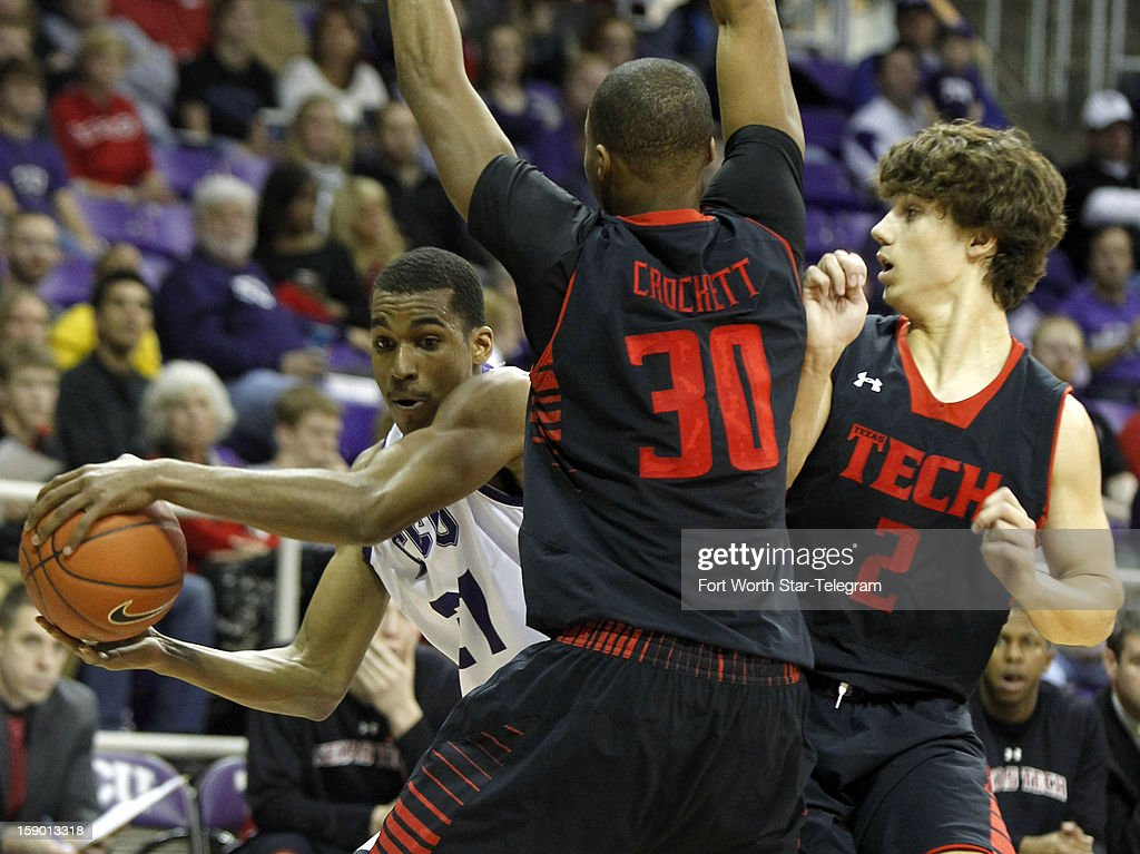 Texas Christian University's Nate Butler Lind, left, tries to move past Texas Tech defenders Jaye Crockett (30) and Dusty Hannahs (2) in the first half at Daniel-Meyer Coliseum in Fort Worth, Texas, Saturday, January 5, 2013. Texas Tech defeated TCU, 62-53.