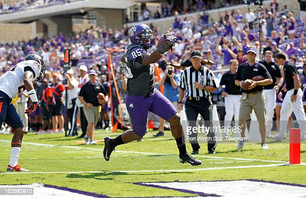 Texas Christian wide receiver LaDarius Brown takes a Casey Pachall pass to the end zone in the fourth quarter past Virginia cornerback Maurice Canady...
