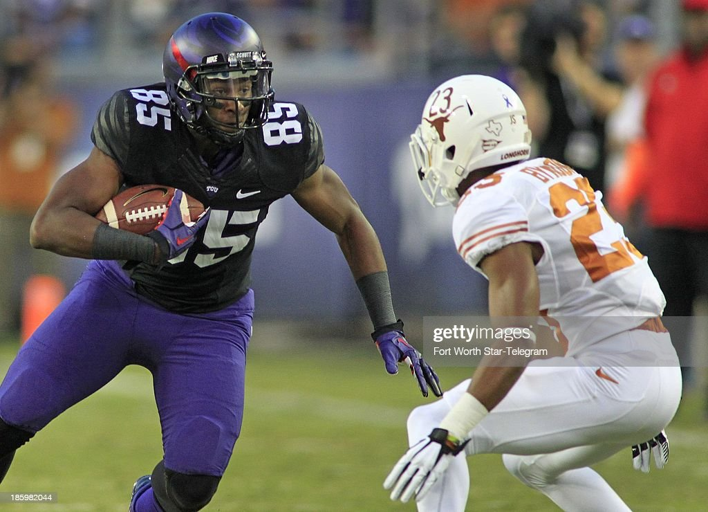 Texas Christian wide receiver wide receiver LaDarius Brown (85) makes a play with the ball in the first quarter against Texas at Amon Carter Stadium in Fort Worth, Texas, on Saturday, October 26, 2013.