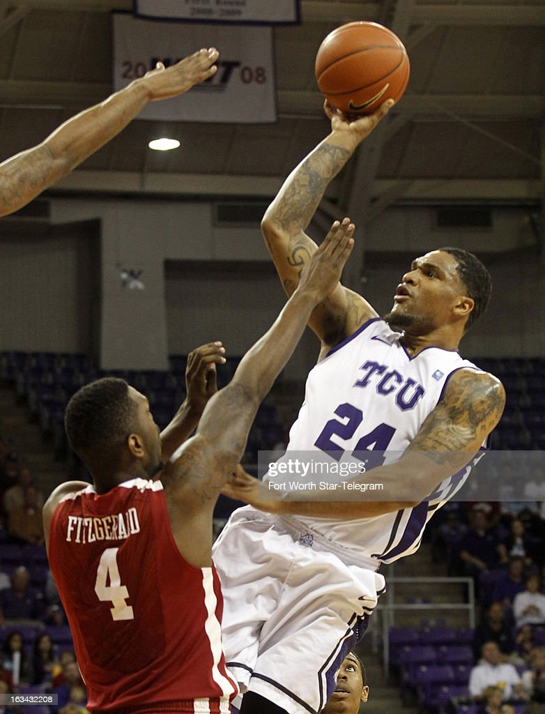 Texas Christian's Adrick McKinney (24) puts up a shot against Oklahoma's Andrew Fitzgerald (4) in the first half at Daniel-Meyer Coliseum in Fort Worth, Texas, on Saturday, March 9, 2013. TCU prevailed, 70-67.