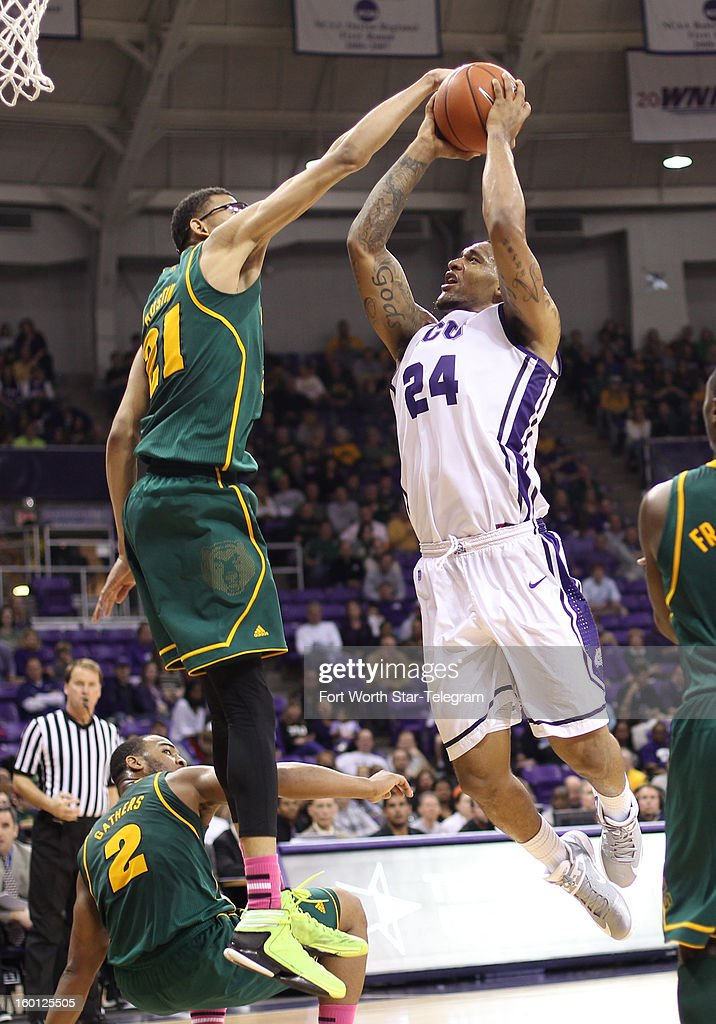 Texas Christian's Adrick McKinney (24) shoots against Baylor's Isaiah Austin during the first half at Daniel-Meyer Coliseum in Fort Worth, Texas, on Saturday, January 26, 2013. Baylor won, 82-56.