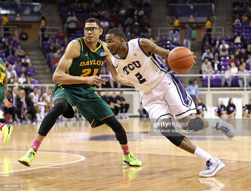 Texas Christian's Connell Crossland (2) drives against Baylor's Isaiah Austin (21) during the first half at Daniel-Meyer Coliseum in Fort Worth, Texas, on Saturday, January 26, 2013. Baylor won, 82-56.
