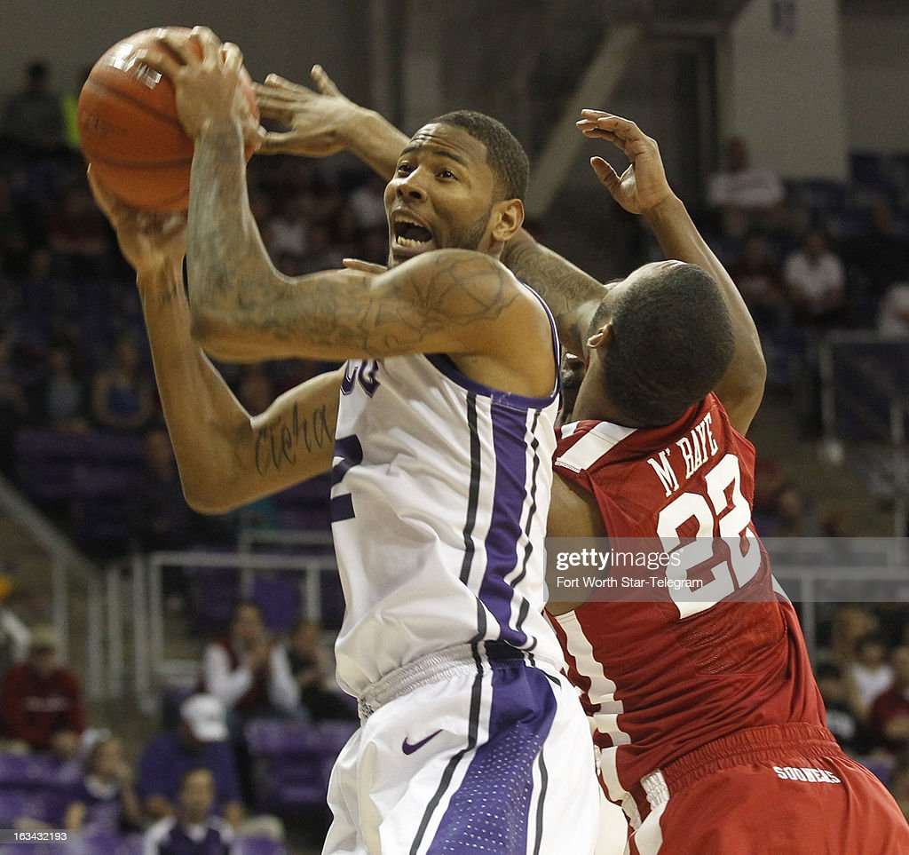 Texas Christian's Connell Crossland (2) goes for a shot in the first half as Oklahoma's Amath M'Baye (22) defends at Daniel-Meyer Coliseum in Fort Worth, Texas, on Saturday, March 9, 2013. TCU prevailed, 70-67.
