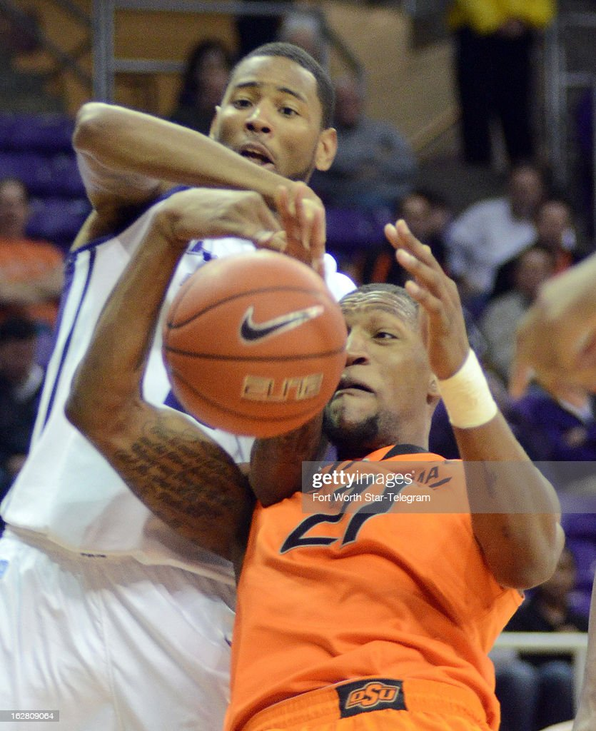 Texas Christian's Connell Crossland, left, battles for a loose ball with Oklahoma State's Kamari Murphy during the second half on Wednesday, February 27, 2013, at the Daniel-Meyer Colesium in Fort Worth, Texas. Oklahoma State won, 64-47.