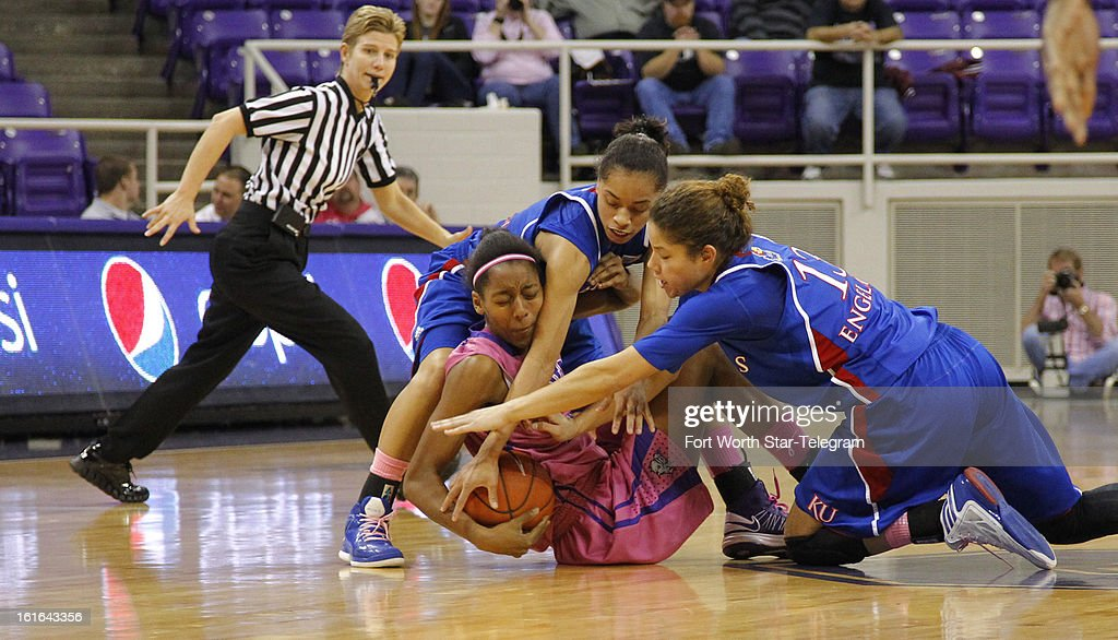 Texas Christian's Delisa Gross (22) tries to hang on to the ball as Kansas' Angel Goodrich (3) and Monica Engelman (13) fight to get it in the second half at Daniel-Meyer Coliseum in Fort Worth, Texas, on Wednesday, February 13 2013. Kansas rallied for a 76-75 win.