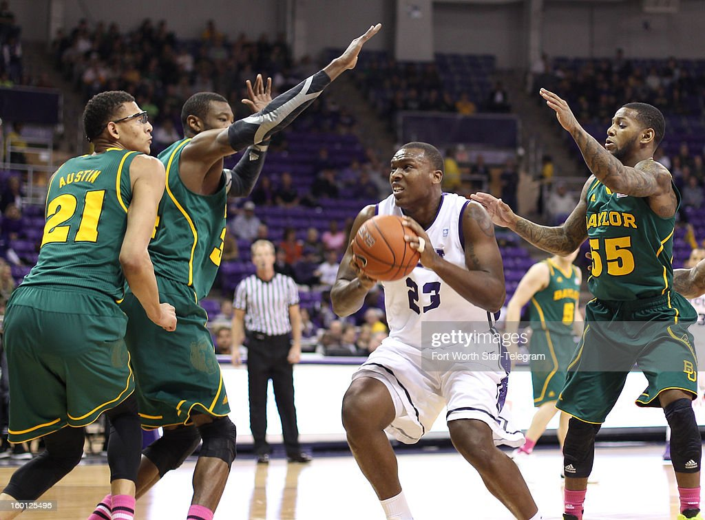 Texas Christian's Devonta Abron (23) drives against Baylor's Isaiah Austin (21), Pierre Jackson (55) and Cory Jefferson during the first half at Daniel-Meyer Coliseum in Fort Worth, Texas, on Saturday, January 26, 2013. Baylor won, 82-56.