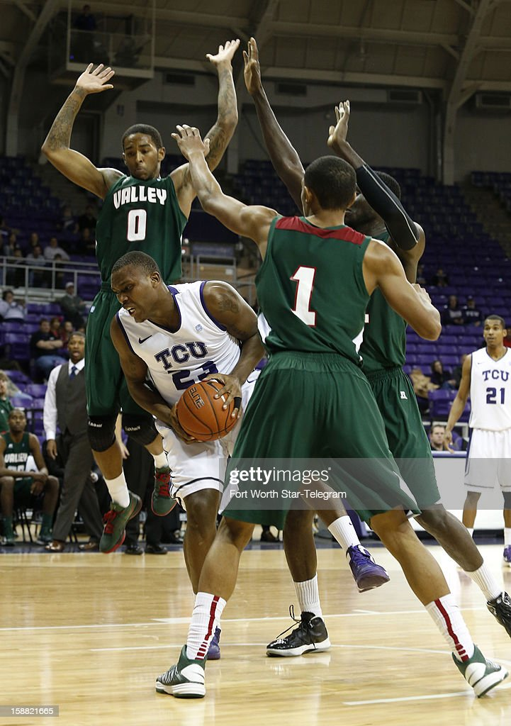 Texas Christian's Devonta Abron grabs a rebound away from the Mississippi Valley State's defense at Daniel Meyer Coliseum on Sunday, December 30, 2012, in Fort Worth, Texas.