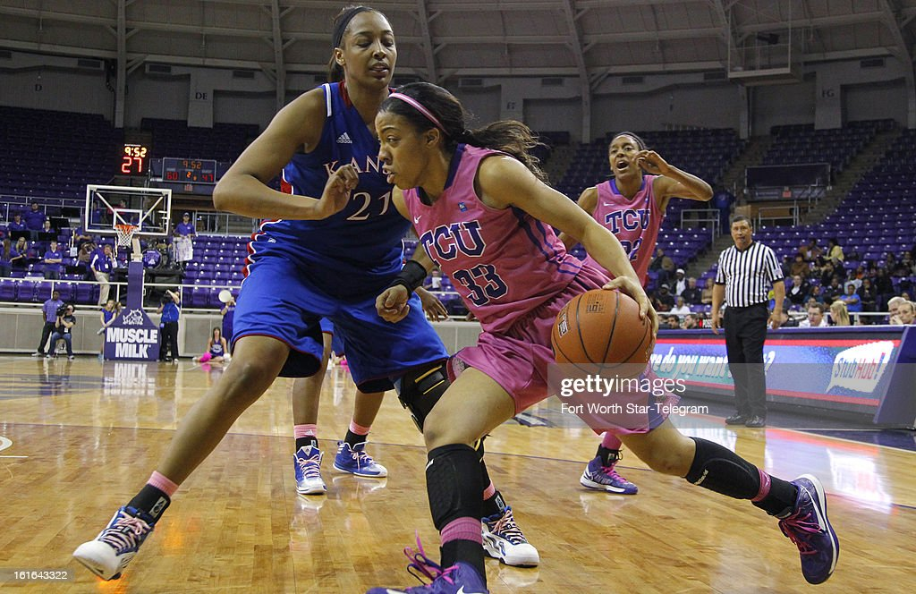 Texas Christian's Donielle Breaux (33) drives against Kansas' Carolyn Davis (21) in the second half at Daniel-Meyer Coliseum in Fort Worth, Texas, on Wednesday, February 13 2013. Kansas rallied for a 76-75 win.