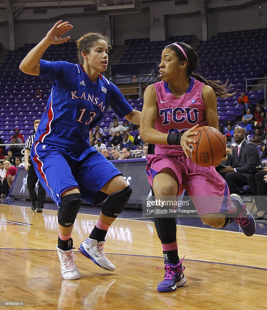 Texas Christian's Donielle Breaux (33) drives against Kansas' Monica Engelman (13) in the second half at Daniel-Meyer Coliseum in Fort Worth, Texas, on Wednesday, February 13 2013. Kansas rallied for a 76-75 win.