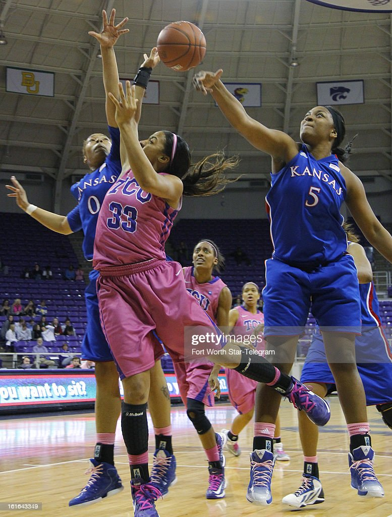 Texas Christian's Donielle Breaux (33) tries to control a rebound against Kansas' Asia Boyd (0) and Catherine Williams (5) in the second half at Daniel-Meyer Coliseum in Fort Worth, Texas, on Wednesday, February 13 2013. Kansas rallied for a 76-75 win.