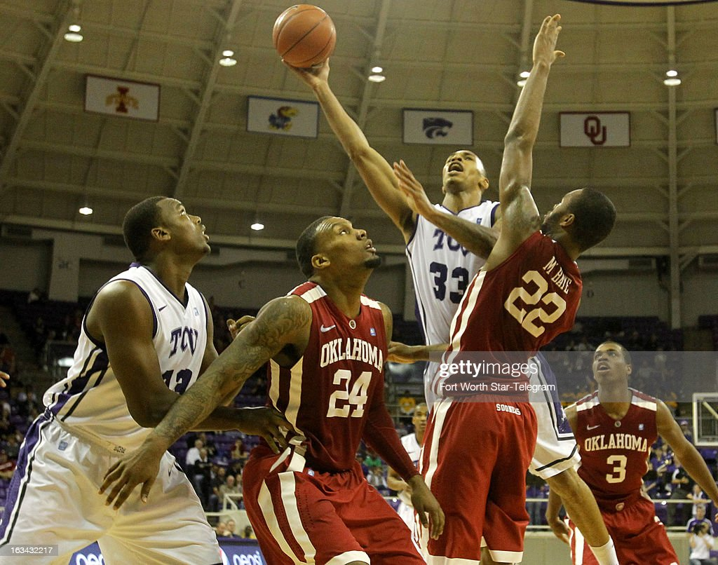 Texas Christian's Garlon Green (33) goes up over Oklahoma's Romero Osby (24) and Amath M'Baye (22) in the second half at Daniel-Meyer Coliseum in Fort Worth, Texas, on Saturday, March 9, 2013. TCU prevailed, 70-67.