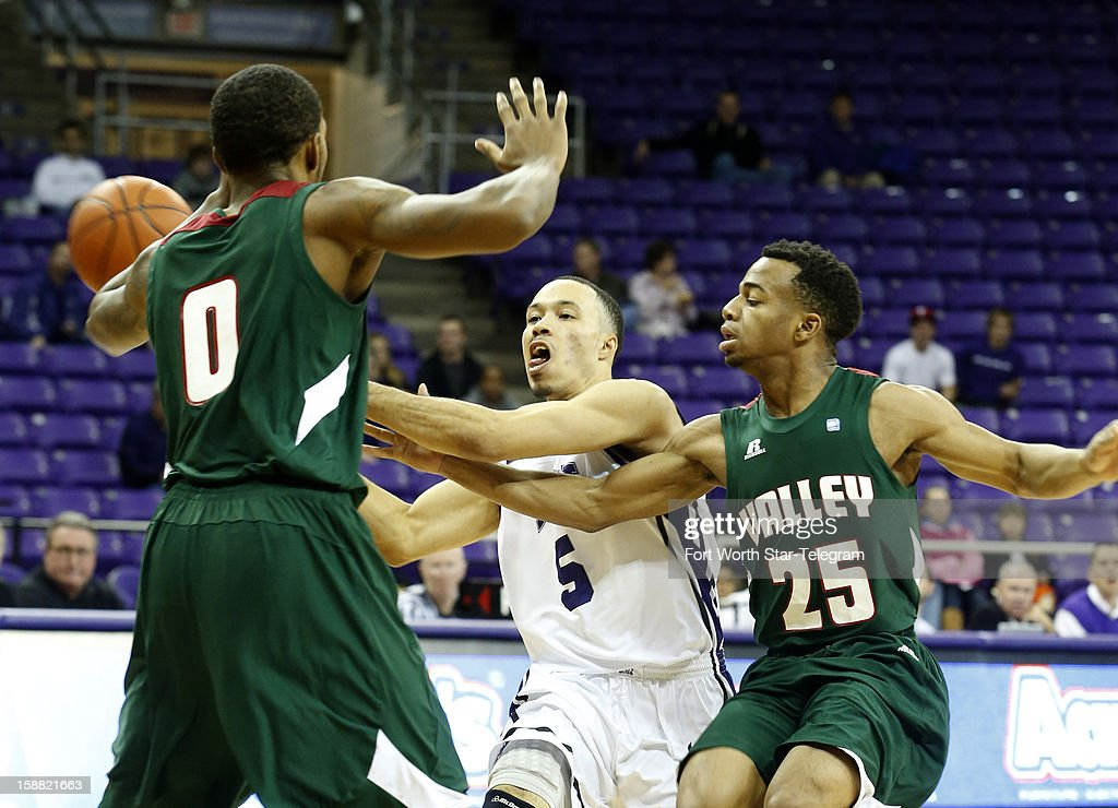 Texas Christian's Kyan Anderson passes the ball while under pressure from Mississippi Valley State's Davon Usher (0) and Darius Tomlin (25) at Daniel Meyer Coliseum on Sunday, December 30, 2012, in Fort Worth, Texas.