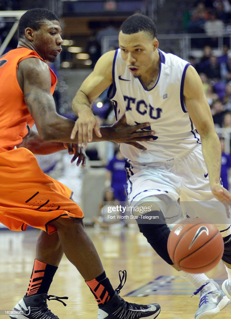 Texas Christian's Kyan Anderson, right, drives against Oklahoma State's Marcus Smart during the second half on Wednesday, February 27, 2013, at the Daniel-Meyer Colesium in Fort Worth, Texas. Oklahoma State won, 64-47.