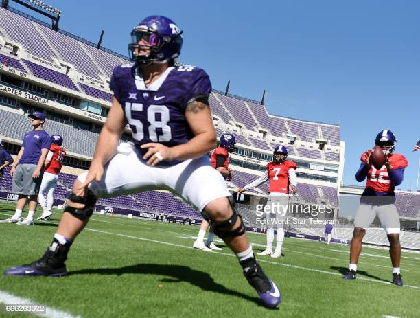 Texas Christian's Patrick Morris left hikes the ball to quarterback Shawn Robinson during warmup drills before the Horned Frogs' spring scrimmage on...