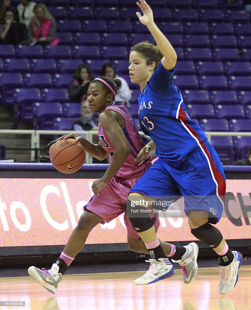 Texas Christian's Zahna Medley, left, brings the ball up against Kansas' Monica Engelman (13) in the second half at Daniel-Meyer Coliseum in Fort Worth, Texas, on Wednesday, February 13 2013. Kansas rallied for a 76-75 win.