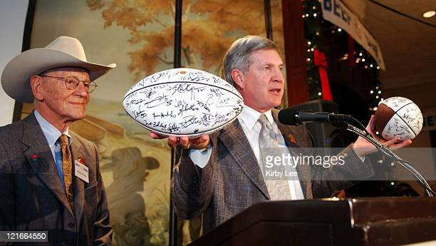 Texas coach Mack Brown presents autographed Longhorns footballs to Lawry's Restaurants Inc chairman Richard N Frank at the 50th Lawry's Beef Bowl at...