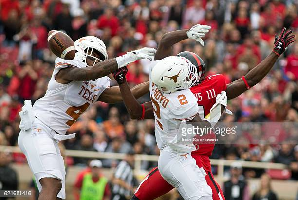 Texas cornerback Kris Boyd and safety Justin Stockton tries to track up the pass to Texas Tech wide receiver Reginald Davis III during the game...
