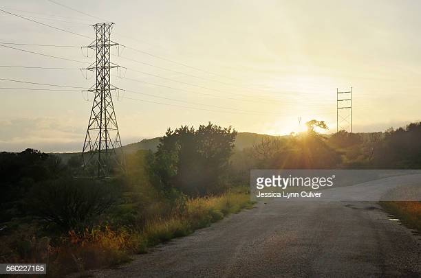 Texas country road with power lines at sunset