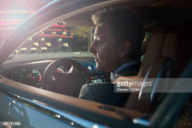 USA, Texas, Dallas, Businessman driving car