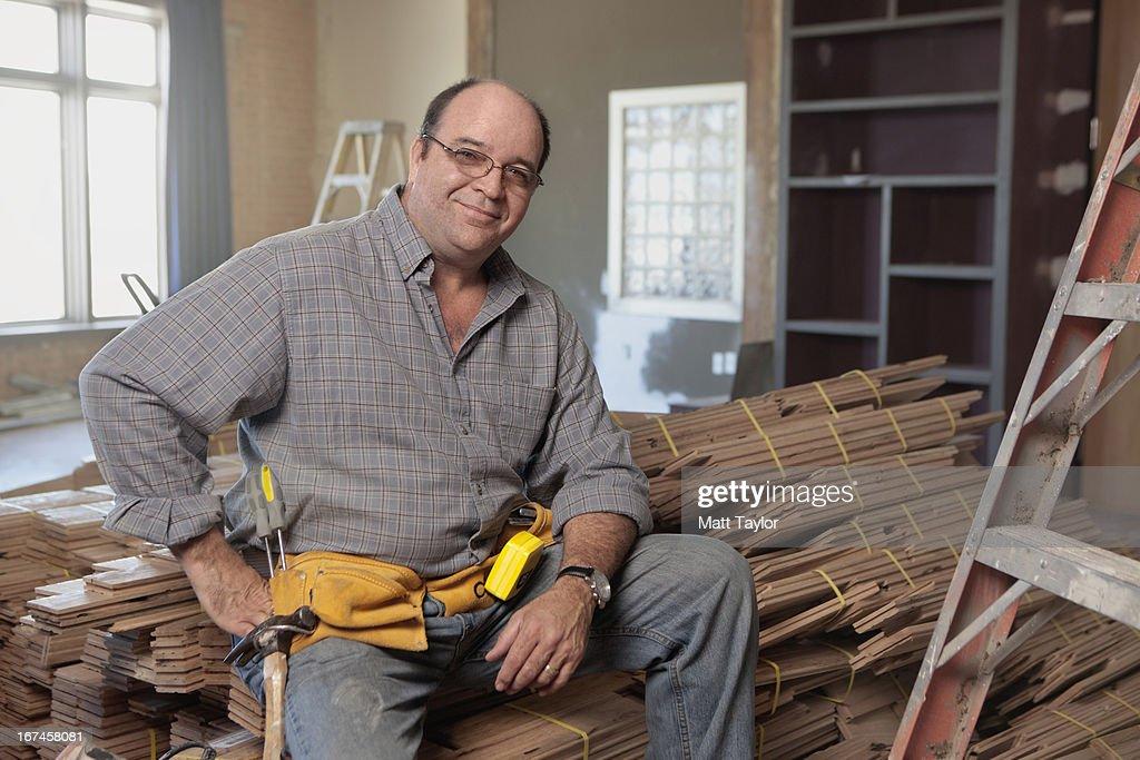 USA, Texas, Dallas, Man sitting on stack of planks  : Stock Photo