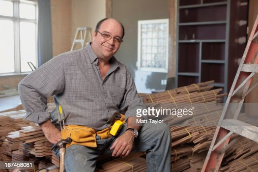 USA, Texas, Dallas, Man sitting on stack of planks  : Stock Photo