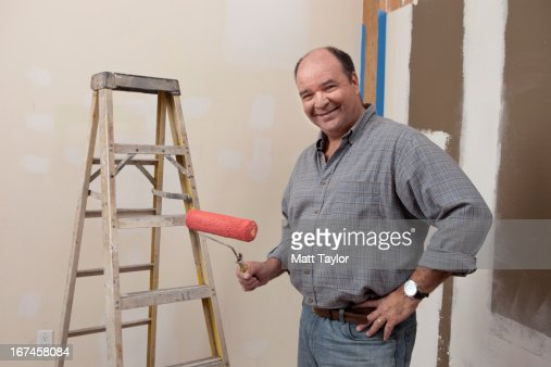 USA, Texas, Dallas, Portrait of man holding paint roller : Stock Photo