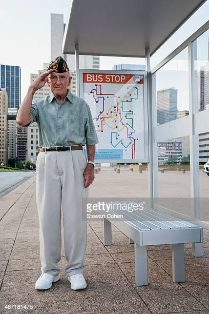 USA, Texas, Dallas, Senior man standing and saluting at bus stop
