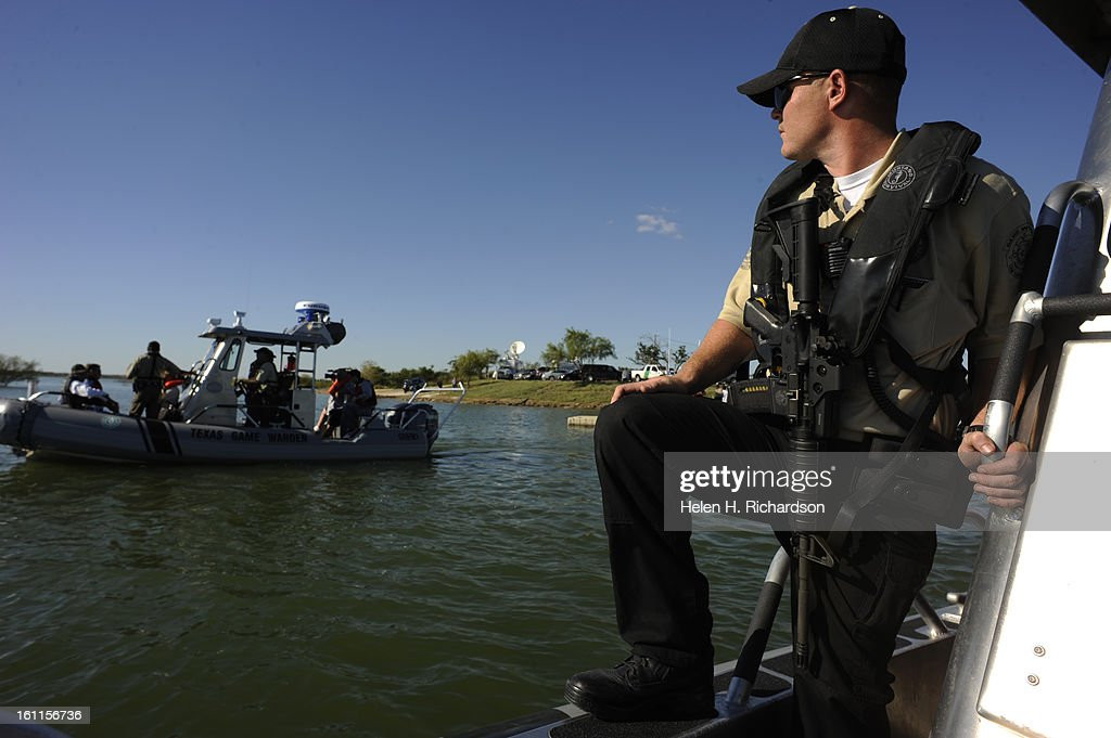 Texas game wardens such as Jake Mort carrying M16 semiautomatic rifles constantly patrol Falcon Lake for any kind of illegal activity whether it be...