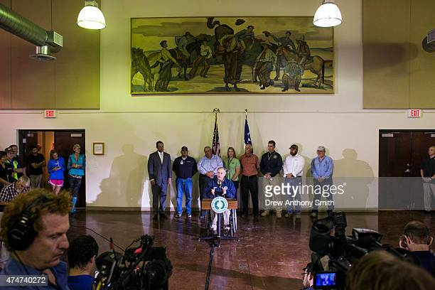 Texas Gov Greg Abbott speaks at a news conference at the Wimberley Community Center May 25 2015 in Wimberly Texas Abbott toured the damage zone where...