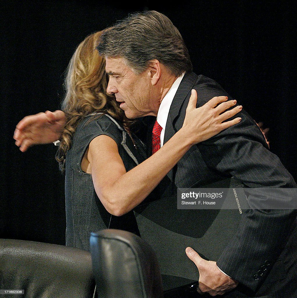 Texas Gov. <a gi-track='captionPersonalityLinkClicked' href=/galleries/search?phrase=Rick+Perry+-+Politician&family=editorial&specificpeople=175872 ng-click='$event.stopPropagation()'>Rick Perry</a> (R) is embraced by Elizabeth Graham, director of the Texas Right to Life, after Perry spoke to the National Right to Life convention at the Hyatt Regency DFW International Airport Hotel June 27, 2013 in Grapevine, Texas. Perry has reportedly vowed to continue the fight for a more restrictive abortion law in Texas after the state legislature failed to get the law passed during a special session because of a filibuster and protests.