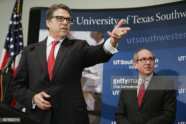 Texas Gov Rick Perry leads a press conference with UT Southwestern Medical Center President Daniel Podolsky and other health and hospital officials...