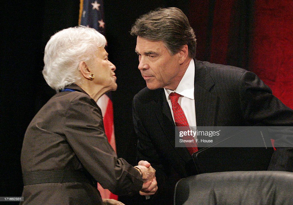 Texas Gov. Rick Perry (R) leans over to kiss Geline B. Williams, chairman of the board for the National Right to Life, after Perry spoke to the National Right to Life convention at the Hyatt Regency DFW International Airport Hotel June 27, 2013 in Grapevine, Texas. Perry has reportedly vowed to continue the fight for a more restrictive abortion law in Texas after the state legislature failed to get the law passed during a special session because of a filibuster and protests.