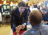 Texas Gov RIck Perry RIck Perry votes in the midterm elections at a grocery store polling location October 18 2010 in Austin Texas Perry is seeking...
