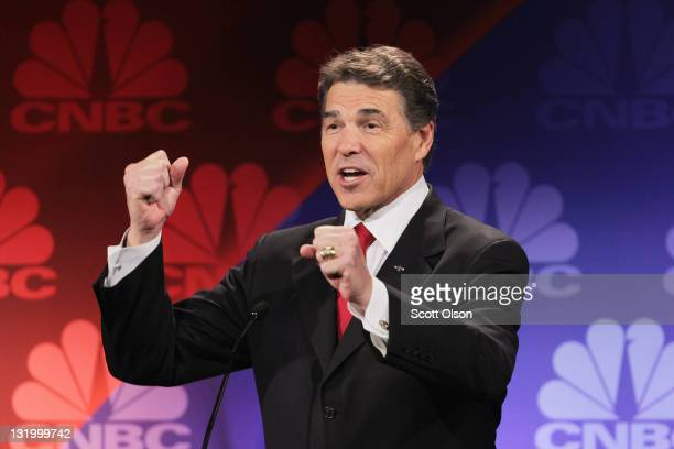 Texas Gov Rick Perry speaks during a debate hosted by CNBC and the Michigan Republican Party at Oakland University on November 9 2011 in Rochester...
