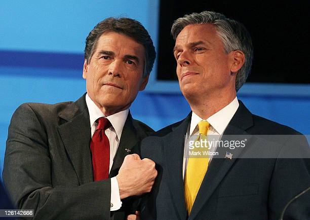 Texas Gov Rick Perry stands with Jon Huntsman participate in the Fox News/Google GOP Debate at the Orange County Convention Center on September 22...