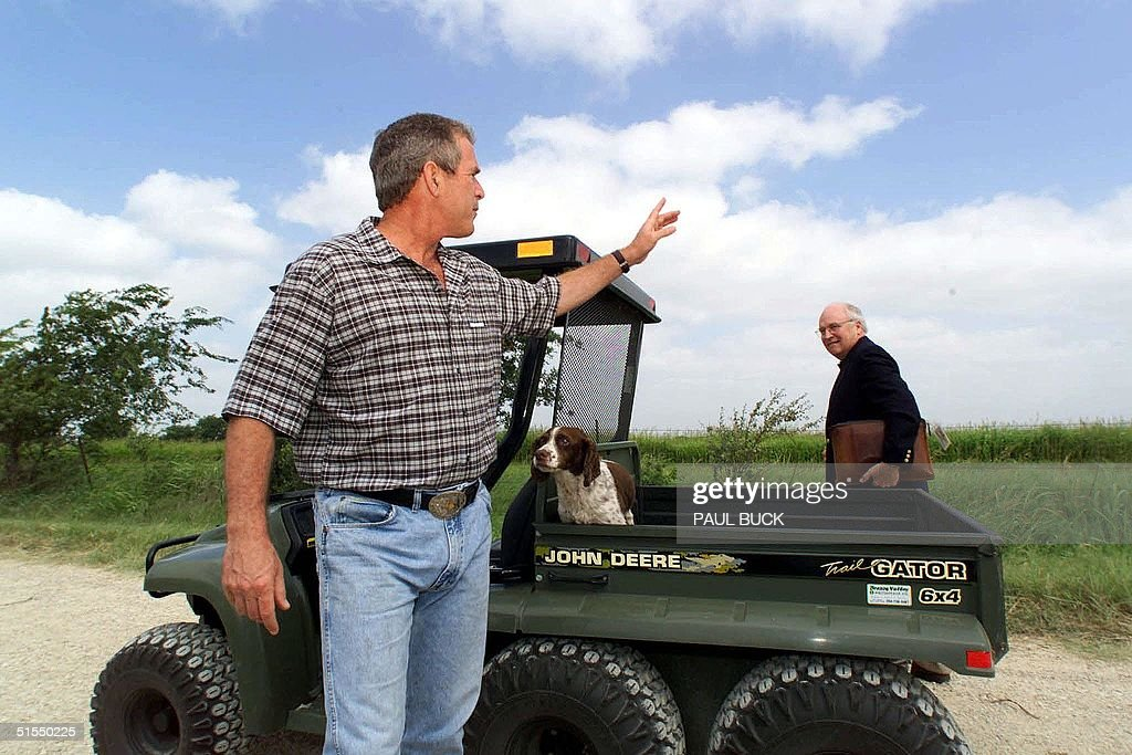 Texas Governor and Republican presidential candidate George W Bush and former US Secretary of Defense Dick Cheney board a utility vehicle after...