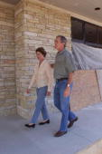 Texas Governor and Republican presidential candidate George W Bush and his wife Laura look over their ranch with their dog Spot a descendent of the...