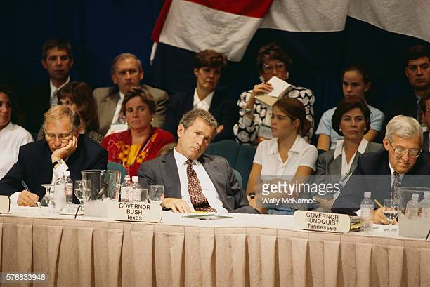 Texas Governor George W Bush and Tennessee Governor Don Sundquist listen to a speech being made by President Bill Clinton