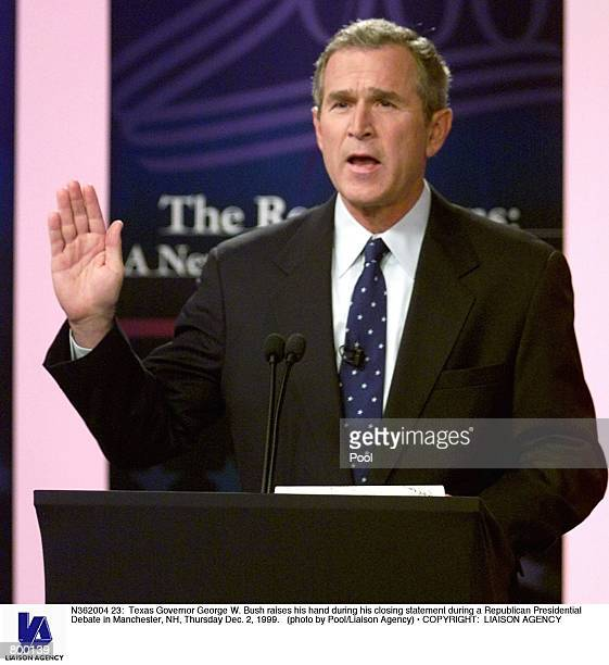 Texas Governor George W Bush raises his hand during his closing statement during a Republican Presidential Debate in Manchester NH Thursday Dec 2 1999