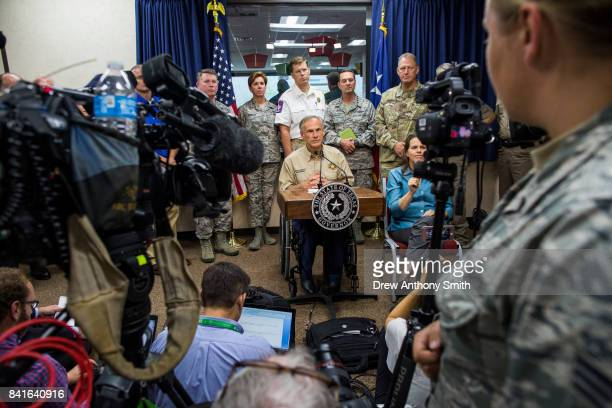 Texas Governor Greg Abbott answers questions following a briefing to the public on Hurricane Harvey at the Texas Department of Public Safety building...