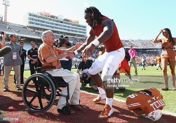 Texas governor Greg Abbott greets Malik Jefferson of the Texas Longhorns after a 2417 win against the Oklahoma Sooners during the 2015 ATT Red River...