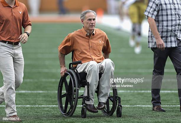 Texas Governor Greg Abbott is seen on the field prior to the game between the Texas Longhorns and the Notre Dame Fighting Irish at Darrell K...