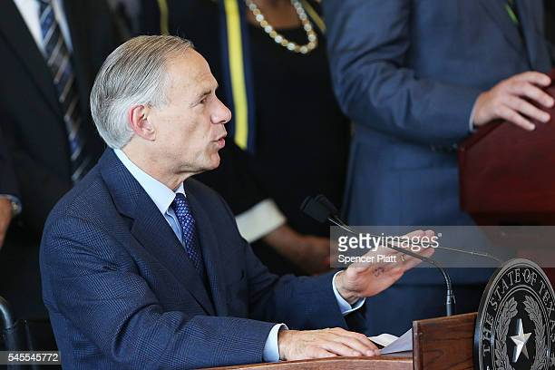 Texas Governor Greg Abbott speaks at Dallas's City Hall near the area that is still an active crime scene in downtown Dallas following the deaths of...