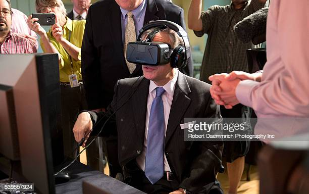 Texas Governor Greg Abbott tests the Oculus virtual reality device at Advanced Micro Devices in Austin following a bill signing that reduced Texas'...