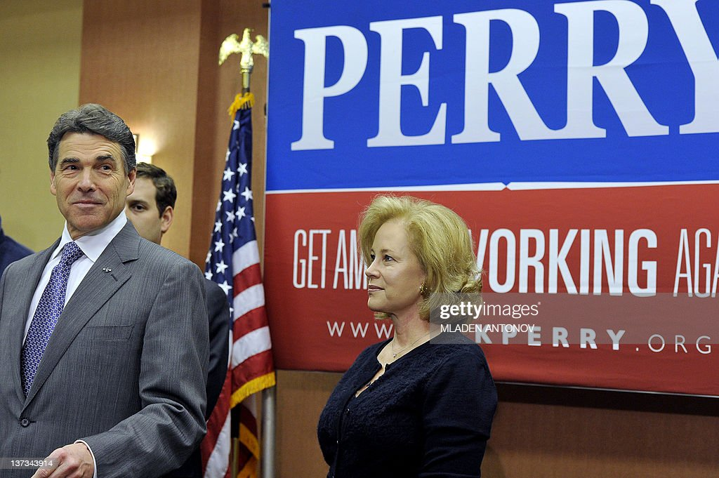 Texas Governor Rick Perry announces that he is suspending his campaign as a Republican presidential candidate as he stands next to his wife Anita, January 19, 2012, in Charleston, South Carolina, in advance of this weekend's January 21, 2012 Republican presidential primary. AFP PHOTO/Mladen ANTONOV